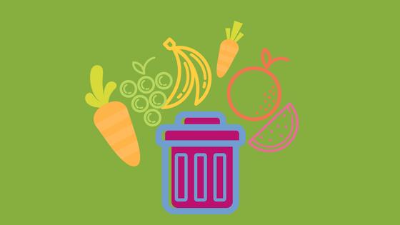 Obst und Gemüse um einen Mistkübel